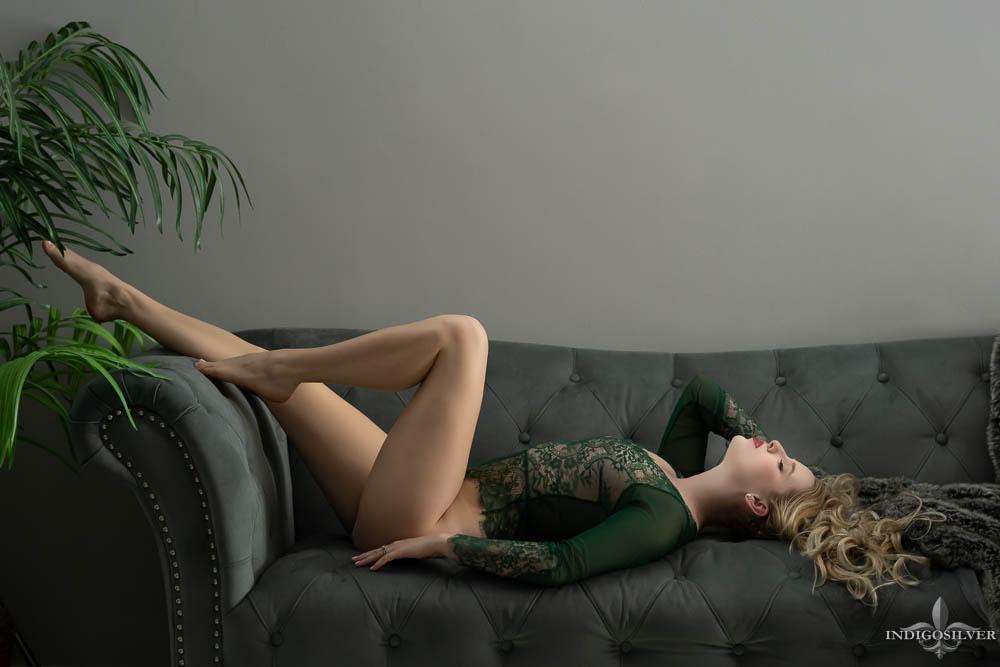 boudoir portrait in green lace bodysuit showing long legs